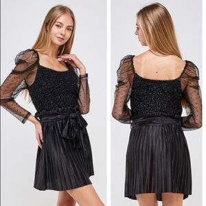 Sparkly black polka dot sheer sleeve textured top